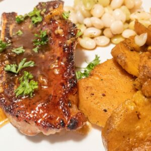 Gluten Free Honey Glazed Pork Chops, Candied Sweet Potatoes and Butter Beans Plated